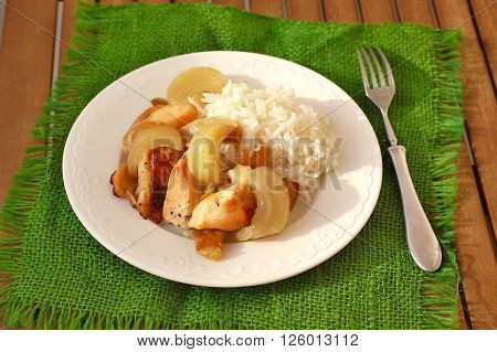 Rosted Chicken With Apples, Onion And Rice On The Green Gunny Cloth