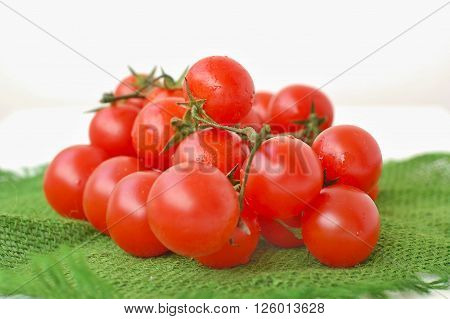 Tomatoes On The Green Gunny Cloth On The White Background