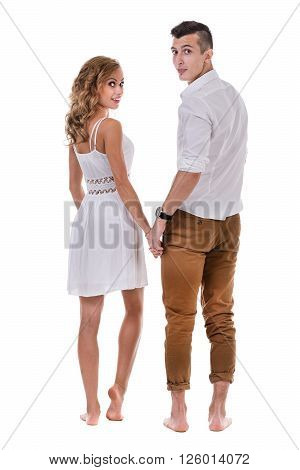 Happy young couple. Portrait of cheerful couple smiling against isolated white background in full length with copyspace