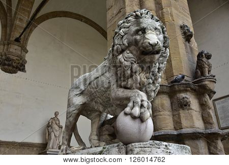 Marble lion statue at the entrance (right side) of Loggia dei Lanzi in Florence an ancient roman sculputure from 2nd century