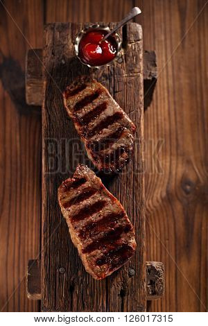 beef marbled steak with vintage old wooden background