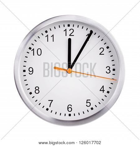 Five minutes past twelve on the round dial