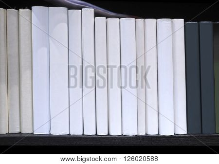 Book spine no have word display on bookshelf in library at University School house