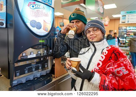 NEW YORK - CIRCA MARCH 2016: customers at 7-Eleven shop. 7-Eleven (7-11) is an international chain of convenience stores, headquartered in the American city of Dallas, Texas.