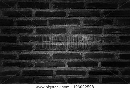 close up texture of layer vintage bricks in black and white color dark vignette