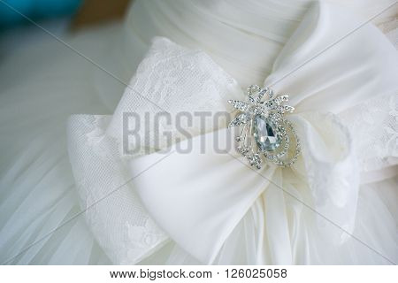 wedding dress hanging on a hanger in hotell