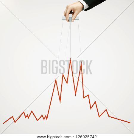 Businessman hand manipulating graph on light background