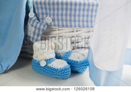 Blue baby boy shoes in children room.