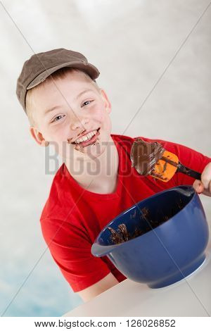 Boy Next To Mixing Bowl And Spatula With Chocolate