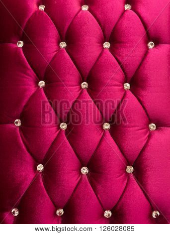 Red upholstery velveteen decorated with crystals as texture and pattern