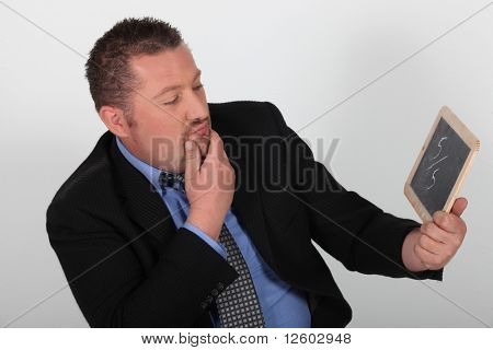 Portrait of a businessman with a note on slate