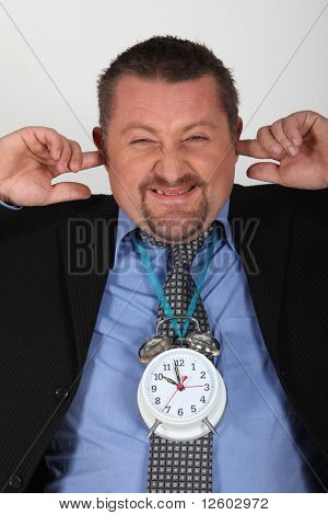 Portrait of a businessman with alarm clock