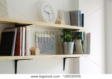 Books on a wooden shelf. Interior design
