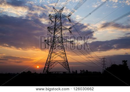 Silhouette of High Power Electricity Pole with Beautiful Sunset in the Background