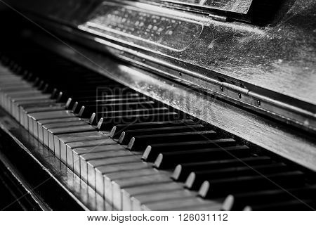 Old rusty piano keyboard, selective focus, black and white