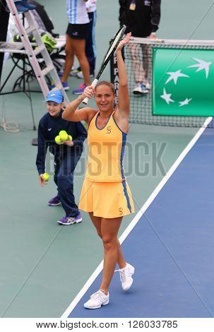 KYIV UKRAINE - APRIL 16 2016: Kateryna Bondarenko of Ukraine reacts after won the BNP Paribas FedCup match against Maria Irigoyen of Argentina at Campa Bucha Tennis Club in Kyiv Ukraine
