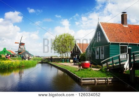 rural dutch scenery of small old houses and canal in Zaanse Schans, , Netherlands, retro toned
