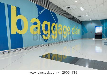 DENPASAR, BALI - MARCH 4, 2016: Baggage claim area. Airport terminal with baggage carousels for travelers