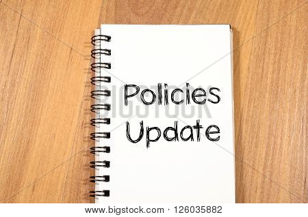 Policies update text concept write on notebook