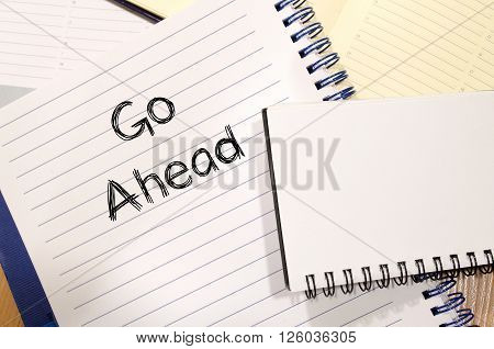 Go ahead text concept write on notebook