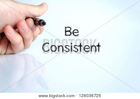 Be consistent note in business man hand