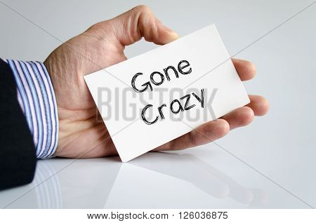 Gone crazy note in business man hand