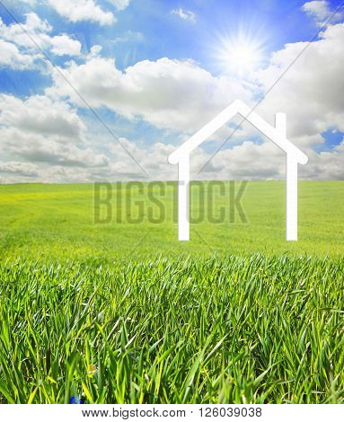 Iconic symbol of a house on a green landscape.