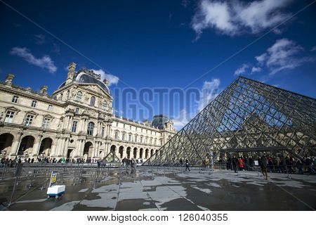 PARIS, FRANCE - MARCH 27, 2016: Louvre museum in the spring. Louvre museum is one of the largest and most visited museums worldwide