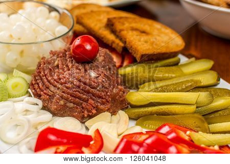 Raw beef Steak tartare with onion and toast