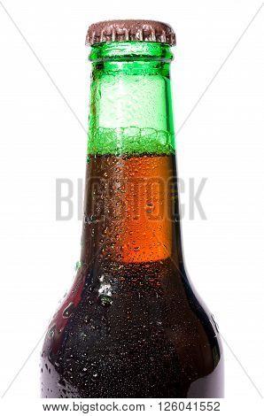 Dark beer bottle close up on white background