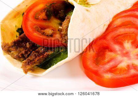 Doner kebab with tomato on white background