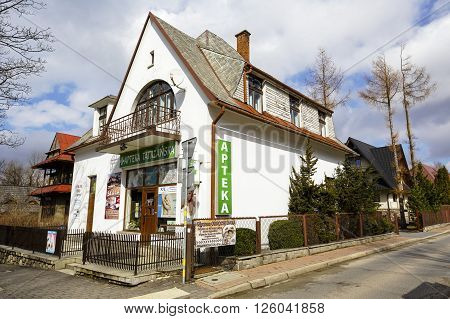 ZAKOPANE POLAND - MARCH 09 2016: residential building named Szarotka made of brick approx. 1920 located at Zamoyski street registered in municipal records of architectural monuments of the city
