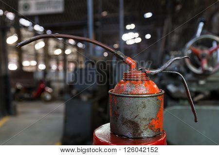Old oil jar in the factory, dirty oil jar