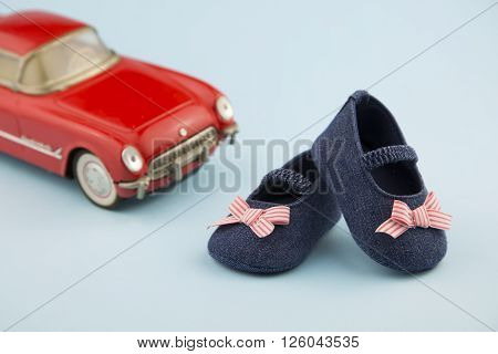 portrait in 50's style of a pair of little girl shoes