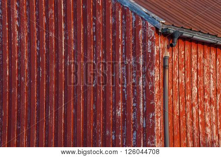 A grunge weathered home with a broken gutter