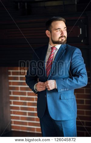 A young bearded businessman monitors external aspects