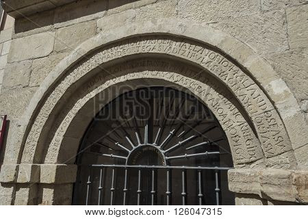 Latin inscription detail in the arch of Ermita de San Gregorio hermitage (Bishop of Ostia). Landmark for pilgrims on the road to Santiago de Compostela Way of Saint James. Logroño La Rioja. Spain.