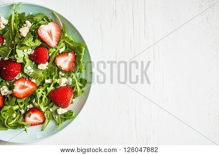 Image of Salad With Arugula on Rustic Background