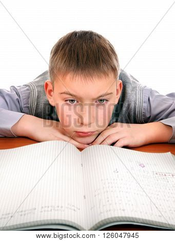 Sad and Tired Kid on the School Desk Isolated on the White Background