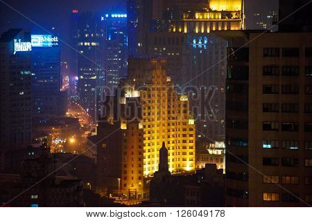 SHANGHAI CHINA - MARCH 19 2015: Details of Shanghai cityscape. Skyscrapers of Huangpu district at night.