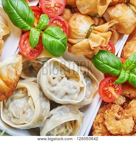 Asian snacks in white bowls. Asian cuisine