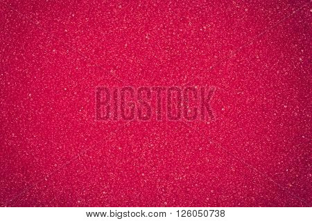 Red spongy macro texture background cloae up