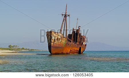Shipwreck near Githio, Greece with a tropical beach in background