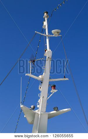 Mast of a ferry and a blue sky