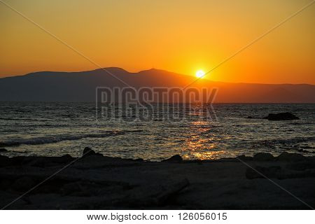 Sunset at the beach at the Naxos island