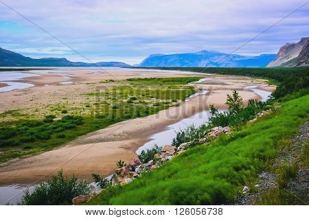 Northern Norwegian landscape with fjords mountains and shore with moss