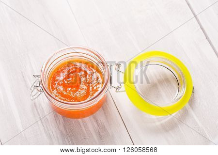 Homemade DIY natural very hot caribean habanero and pineapple sauce on a beautiful wooden table