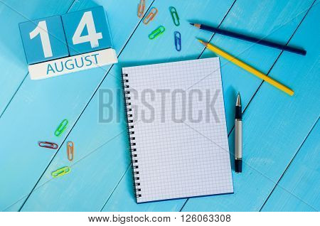 August 14th. Image of august 14 wooden color calendar on blue background. Summer day. Empty space for text.
