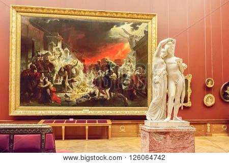 SAINT PETERSBURG RUSSIA - APRIL 11 2016: Room with paintings Karl Brullov in State Russian Museum. The museum is the largest depository of Russian fine art in St. Petersburg