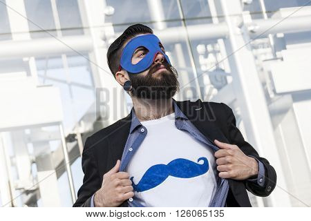 young hipster superhero shows your symbol in town
